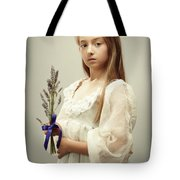 Young Girl Holding Lavender Tote Bag