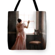 Young Lady In Pink Gown Looking Out Window Tote Bag