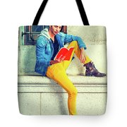 Young Man Reading Red Book, Sitting On Street Tote Bag