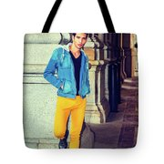Young Man Standing On Street, Relaxing Outside Tote Bag