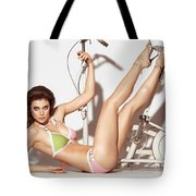 Young Woman In A Swimsuit Posing With Exercise Bike Tote Bag
