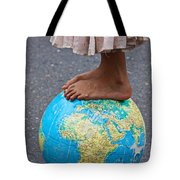 Young Woman Standing On Globe Tote Bag by Garry Gay