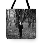 Young Woman With Her Head Tilted Back While Standing In A Forest Tote Bag