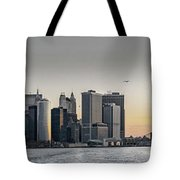 Panoramic View Of Manhattan Island And The Brooklyn Bridge At Su Tote Bag