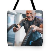 Senior Man Exercising With Ropes At The Gym. Tote Bag