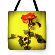 Dying Flower Against A Yellow Background Tote Bag