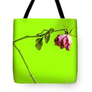 Dying Flower Against A Green Background Tote Bag