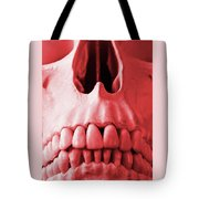 A Close Up Of A Human Skull In Red Tote Bag