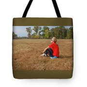 A Woman Is  Sitting In A Park And Admiring The Landscape Tote Bag