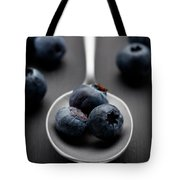 blueberries and a silver spoon on distressed wood No. 2 Tote Bag