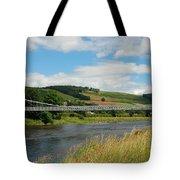 chainbridge over river Tweed at Melrose Tote Bag