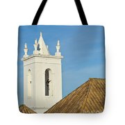 Church Bell Tower Behind Tiled Roofs In Tavira Tote Bag
