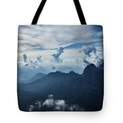 Moody Cloudy Mountains With A Lot Of Contrast And Shadows And Clouds Tote Bag