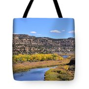 Distant Boat On The San Juan River In Fall Tote Bag
