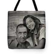 Father And Daughter Tote Bag by Ron Cline