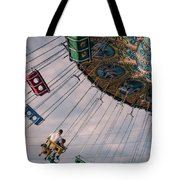 Father And Son On The Swings Tote Bag