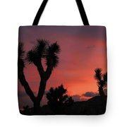 Joshua Trees Silhouetted Against A Red Sky Tote Bag