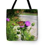 Monarch Butterfly Danaus Plexippus On A Thistle Tote Bag