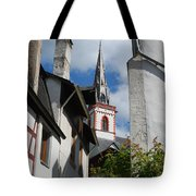 old historic church spire and houses in Ediger Germany Tote Bag