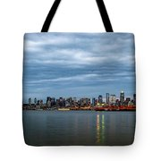 Panorama Of Seattle Skyline At Night With Storm Clouds Tote Bag