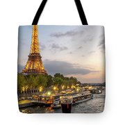 Portrait View Of The Eiffel Tower At Night With Wine Glass In The Foreground Tote Bag