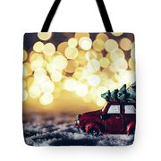 Red Car With Christmas Tree Driving Through Snow Tote Bag