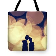 Romantic Couple Kissing On Illuminated Background. Tote Bag