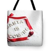 Santa Is Coming Text And Red Ribbon Tote Bag