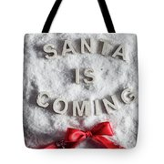 Santa Is Coming Writing And A Red Bow Tote Bag