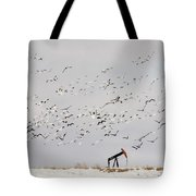 Snow Geese Over Oil Pump 01 Tote Bag by Rob Graham
