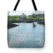 sunlight glistening on water at Eyemouth harbour Tote Bag