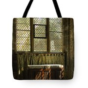 sunlight on linen fold altar in Trinity church York Tote Bag