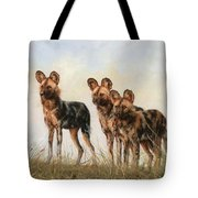 Three African Wild Dogs Tote Bag