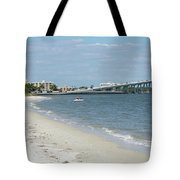 Two Men Set Out On Jet Skis From A Sanibel Island Causeway Islan Tote Bag