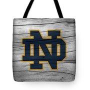 University Of Notre Dame Fighting Irish Logo On Rustic Wood Tote Bag