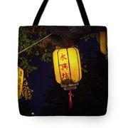 Yellow Chinese Lanterns On Wire Illuminated At Night  Tote Bag