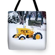 Yellow Tractor In The Snow Tote Bag