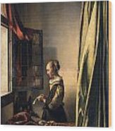 Girl Reading A Letter By An Open Window Wood Print by Johannes Vermeer