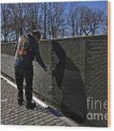 Vietnam Veteran Pays Respect To Fallen Soldiers At The Vietnam War Memorial Wood Print