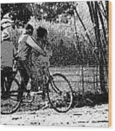 3 Young Children On A Cycle At The Side Of The Road Wood Print