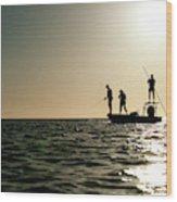 A Couple Fish As A Man Pilots A Small Wood Print