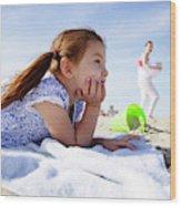 A Cute Little Hispanic Girl In A Summer Wood Print