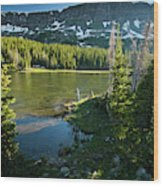 A Fly Fisherman Fishes A High Alpine Wood Print