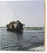 A Houseboat Moving Placidly Through A Coastal Lagoon In Alleppey Wood Print