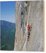 A Man Aid Climbing Wood Print