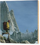 A Man Backpacks In Front Of Fitz Roy Wood Print