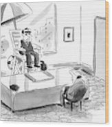 A Man Sits In A Tall Lifeguard Chair Wood Print