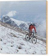 A Mountain Biker Rides Through The Snow Wood Print