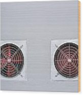 A Pair Of Red Industrial Ventilated Fan On Grey Wall As Backgrou Wood Print