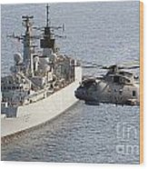 A Royal Navy Merlin Helicopter Passes Over Hms Cumberland Wood Print